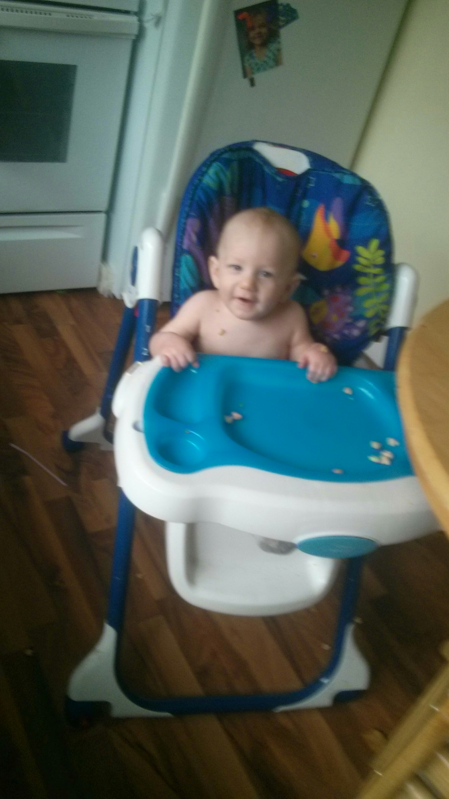 Logan Having Fun In High Chair